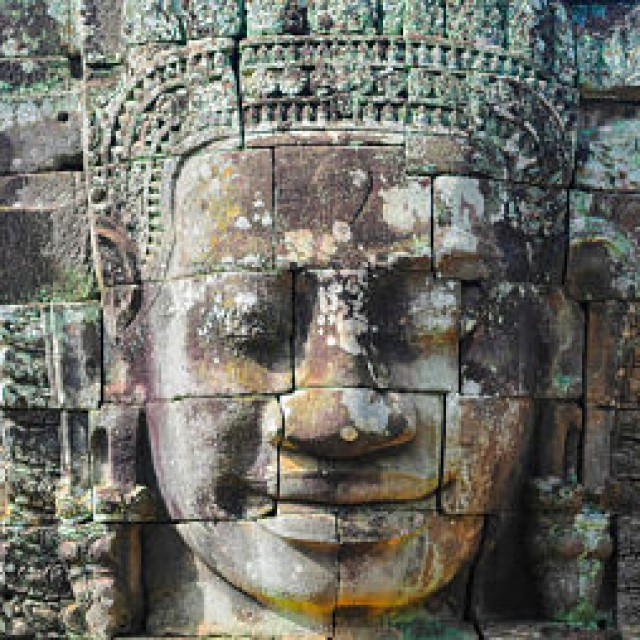 Faces Carved Into Rock In Bayen Temple Cambodia_opt_opt